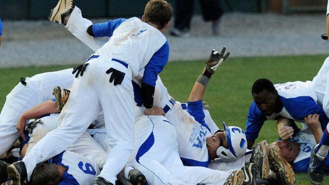 Crenshaw Christian players celebrate beating Lowndes for the AISA State Championship at Paterson Field in Montgomery, Ala., on Tuesday May 5, 2015.