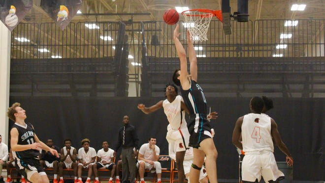 Gulf Coast's Klajd Kiri goes up for the ball during the Sharks' 71-63 win at Lely on Friday, Jan. 19