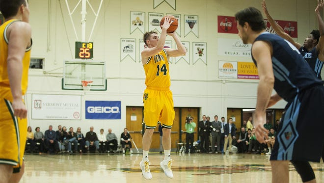 Catamounts guard Cam Ward (14) shoots a 3-pointer during the America East quarterfinal men's basketball game between Maine and Vermont at Patrick Gym on Wednesday night.