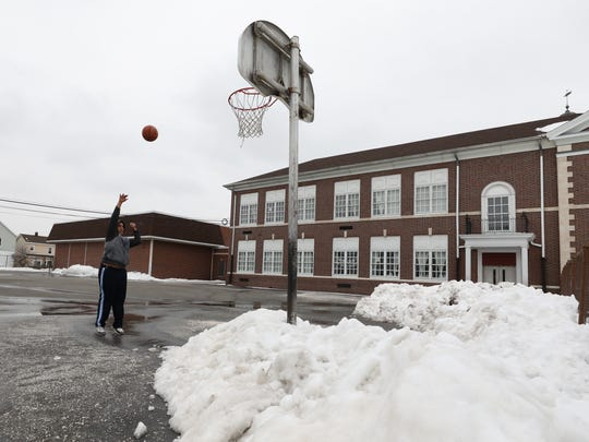 Even with snow surrounding the court, Rafat Saada, 15, of Clifton, came out in the cold to shoot baskets on the asphalt court at Clifton Elementary School 1.