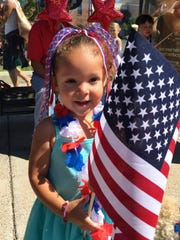 Kaia Baroch, 2, of Great Falls waits for the parade
