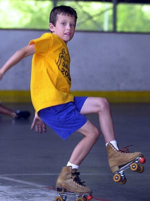 Daniel Kuzemczak, 8, of Yonkers, tries to stay on his feet during a summer camp outing at the Murray Memorial Skating Center in Yonkers in 2002. The kids from Camp Ray in Yonkers spent the day skating, the camp is run by the Yonkers Parks and Recreation Department.