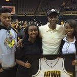 Roy Marble, Iowa's career scoring leader, with children Carlo, Roichelle and Royanah at Carver-Hawkeye Arena.