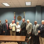Terry Steed, third from left, accepts a commendation plaque Monday from the Forrest County Board of Supervisors. Steed retired as Forrest County Emergency Management Agency Director effective May 1, but will remain on the books until the end of the month.
