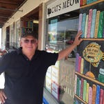 Browseabout Books owner Steve Crane stands outside his store in Rehoboth Beach.