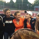 Libby Roetker (center, in orange) celebrates with her Harrison teammates after her three-set victory over Minsun Kim at No. 2 singles gave the Raiders a 3-2 sectional semifinal victory over West Lafayette.