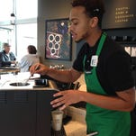 Brandon Mitchell, a barista at the new Starbucks at the North College Marketplace on North College Avenue, prepares specialty coffee made in a Clover machine, an inverted French press that uses vacuum extraction to brew the coffee. The new store is the only Fort Collins Starbucks with the machine.