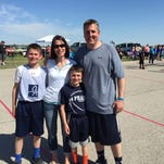 The Jamison Family -- (From left) Tyler, Anna, Alex and Brian pose at the Gus Macker Tournament. Brian Jamison along with his brother Scott (not pictured) and his two sons all played in the event.