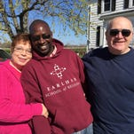 Earlham School of Religion graduate Simon Thiongo, center, shares a tender moment with Anita and Tim Crull on their farm west of Hagerstown.