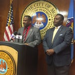 Monroe Police Chief Quentin Holmes (left) and Mayor Jamie Mayo address the media Tuesday about plans to purchase new patrol vehicles for the police department.