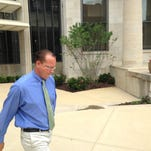 """Bourbon organized crime ring defendant Dustin """"Dusty"""" Adkins of Georgetown leaves the Frankin County Courthouse Friday after pleading not guilty during his arraignment in Franklin Circuit Court."""