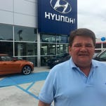 John Klagholz, owner of Interstate Hyundai, said he was honored to win the Thomas H. Scott Award for medium-sized businesses.