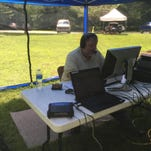 Dave Spoelstra, a member of the Lafayette DX Association, works a radio during a field day event Saturday. More than 35,000 amateur radio operators participate in the American Radio Relay League's annual 24-hour field day.