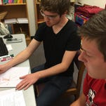 Trevor Boram, left, an Indiana University East junior with a double major in biochemistry and math, tutors Richmond High School senior Ryan Yates in pre-calculus.