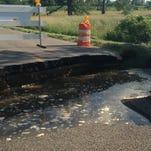 A section of road washed away south of Charlotte on South Cochran Avenue between Bellevue and Butterfield highways on June 23. Many of the roads in Eaton County damaged during the recent storm are still closed.