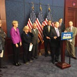 Sen. Chris Coons and Democratic leaders say they are fighting Republican attempts to weaken consumer protections in the Dodd-Frank Wall Street Reform law, which marked its fifth anniversary on Tuesday.