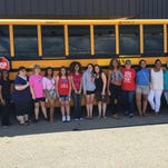 Members of the Everett High School Project UNIFIED cheerleading team are joined by parents and coaches as the group prepares to head for the Special Olympics in Los Angeles Saturday through Aug. 2.