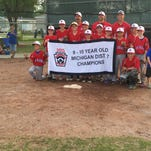 The St. Clair 10-and-under Little League team poses after defeating Ira Township to win the district tournament