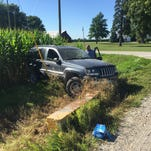 Police search a Jeep Grand Cherokee after two burglary suspects crashed in Montgomery County.