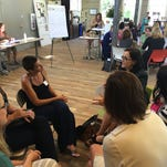 Participants at an EmBe program discuss women and inequality Wednesday at The Bakery.