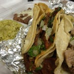An al pastor, left, and a carnitas taco from Micheladas Mexican Grill in North Fort Myers.