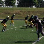 Howell defenders (in green) take on Lowell during Tuesday's four-team scrimmage at Howell High School.