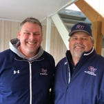 Karl Kling, left, and Ward Mullens have switched jobs in the Cleary University athletic department. Kling has moved from the athletic director's job to sports information, while Mullens moves from sports information to running the athletic department.