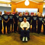 Bossier City Mayor Lorenz Walker joined city council members and staff at Tuesday's city council meeting in wearing a special T-shirt in support of Human Resource Director Jay Plummer who is battling ALS.