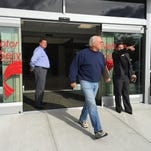 A customer exits the newly renovated Motor Vehicle Service's building in Eatontown on Tuesday.