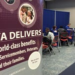 Veterans Affairs employees in Winston-Salem, N.C., help veterans at a claims clinic in January.