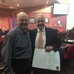 "Retired RGJ reporter Ray Hagar (right) poses with Sparks Mayor Geno Martini (left). He is holding the proclamation that designates Nov. 23 ""Ray Hagar Day"" in the city of Sparks."