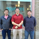 From left, Justin Coaldrake, Morgan Hampel and Tyler Fox — the three cofounders of ClinicNote — stand outside the Global Insurance Accelerator in Des Moines on Thursday, April 30, 2015.