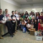 Members of the Hopatcong High School chapter of the National Honor Society before they delivered food to local families.