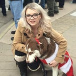 Brandie Shair, 22, of Sparks, scratches her dog Kobi at the Sparks Hometowne Christmas Parade on Saturday.