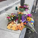 A memorial to slain Department for Children and Families social worker Lara Sobel is seen outside the Barre office building where she was killed in August.