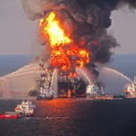 Safety workers try to bring fire under control after Deepwater Horizon explosion.