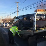 A Ford Edge is towed from the scene of a three-vehicle crash Thursday in Oxford Twp. The driver sustained minor injuries, police said.