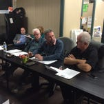 SELCRA Director Derek Smith, center, discusses the agency's future at a December meeting.