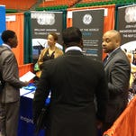 Adonai Hollins, far right, a Spring 2015 FAMU graduate and management assistant at Enterprise Rent-A-Car,  interviews students at Wednesday's Spring Career Expo at FAMU.