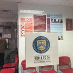 A visitor examines printed literature available at the IRS office on Route 10 in Parsippany.