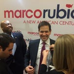 Republican presidential candidate, Sen. Marco Rubio, R-Fla. gestures as he speaks next to his son Anthony Rubio, 10, during a campaign event in Spartanburg, S.C., Wednesday Feb. 10, 2016, his first stop after the New Hampshire primary. (AP Photo/Jacquelyn Martin)