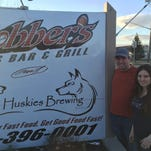 Justin and Venessa Henderson, the husband and wife team behind Three Huskies Brewing, stand outside their brewery in Canandaigua.