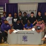 University Academy senior Jon Kelly signs with Louisiana College Monday.