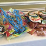 """A pile of packaged breakfast foods on display at the """"Mending the School Environment for Academic Excellence"""" forum on Wednesday. The forum focused on the importance of students starting their days with a health breakfast."""