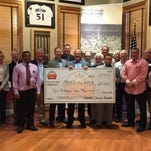 Character and Courage Foundation team members present a grant to Make-A-Wish Foundation.