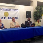 Candidates for the 8th congressional district answer questions at Tuesday's Jackson-Madison County NAACP candidate forum.