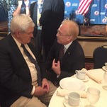 Arcadio Casilas, right, finance chairman for New York State Republicans, talks to former House Speaker Newt Gingrich on Monday, July 18, 2016 at a New York delegation breakfast at the Republican National Convention in Cleveland.