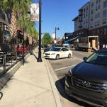 Parking meters at 60 public parking spaces on Madison Street are being enforced 24 hours a day, 7 days a week after a Fort Lauderdale developer was given license to enforce them.