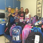 Winners: Catholic Charities delivers donated backpacks