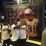 Southern Miss players Deshadrick Truly, left, and Nick Mullens pose for a photo inside the team's newly renovated locker room Wednesday.